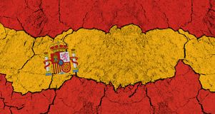 Decline of Spain. Cracks and rough surface in colors of Spanish flag - deterioration, decline, failure and decay of Spain. Troubles and problems leading to Stock Photo