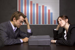 Declining Profits. Business team with declining graph Stock Photography