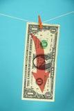 Declino del dollaro americano illustrato sopra il blu Fotografia Stock Libera da Diritti