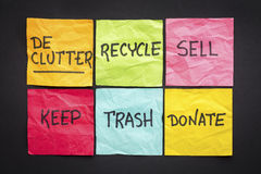 Declutter concept on sticky notes. Declutter concept (keep, recycle, trash, sell, donate - handwriting on color sticky notes against black paper background Stock Image