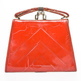 Deco Bag. Stylish red Art Deco Bag isolated on white royalty free stock photo
