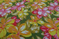 Deco fabric from the 70s with colorful, stylized floral pattern. Detail photo. Colorful deco fabric from the 70s with colorful, stylized floral pattern. Detail Royalty Free Stock Photography