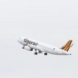 Decole Airbus A320-232 Tiger Airways Foto de Stock Royalty Free