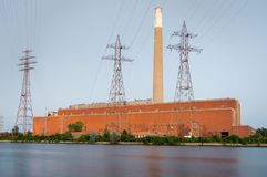 A decommissioned coal fired power plant at dusk royalty free stock photo