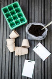 Decomposable bio-degradable pots. Soil, seeds and cell bedding tray Royalty Free Stock Images