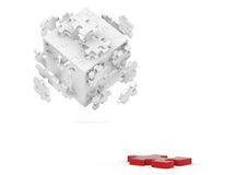 Decomposed cube of puzzle and red element Stock Photography