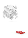 Decomposed cube of puzzle and red element Stock Images