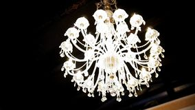 The decor at the Banquet crystal chandelier stock video