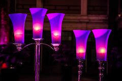 Decor with candles and lamps for corporate event or gala dinner. Pink and Purple Decor with candles and lamps for corporate event or gala dinner Royalty Free Stock Images