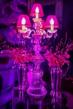 Decor with candles and lamps for corporate event or gala dinner. Pink and Purple Decor with candles and lamps for corporate event or gala dinner Stock Photo
