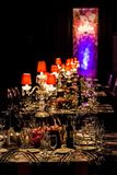 Decor with candles and lamps for corporate event or gala dinner. Pink and Purple Decor with candles and lamps for corporate event or gala dinner Royalty Free Stock Photography