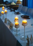 Decor of candles on the table at the festival Stock Images