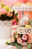 Decor candy bar on girls. Candy bar on children`s birthday decor for girls. cage and vase with flowers stock photos