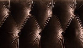 Decor Chesterfield from a brown velvet stock photography