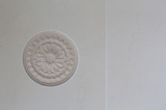Decor element from plaster. On the tile background in the bathroom royalty free stock image