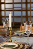 The decor of the festive table. Candle and wine glasses. Close-up Stock Photo