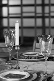 The decor of the festive table. Close-up. Black and white. The decor of the festive table. Candle and wine glasses. Close-up. Black and white Royalty Free Stock Photos