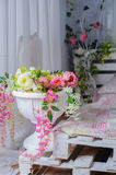 Decor of floral bouquets in Interior. In rustic style Royalty Free Stock Photo
