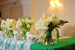 The decor of flowers of the wedding ceremony. In the restaurant Stock Photo