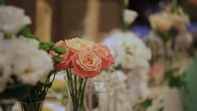Decor of flowers on wedding table stock video footage