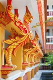 Golden rooster in decoration Cambodian temple. Decor in the form of a gold fiery bird rooster in decoration of the Cambodian monastery Royalty Free Stock Photo
