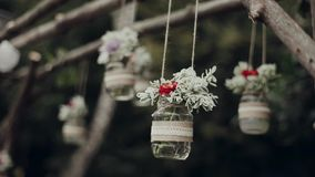 Decor , hanging jars with flowers stock video