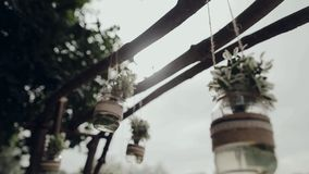 Decor , hanging jars with flowers stock footage