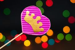 Decor for the holiday. Heart of hand made cardboard on a dark background with bright lights Royalty Free Stock Photo
