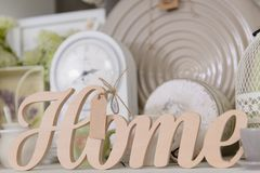 Decor for home in pastel colors. Decor for home in pastel colors in the shop. Wooden sign Home, Close-up Royalty Free Stock Images