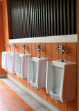 Decor interior of white urinals in men bathroom Royalty Free Stock Photos