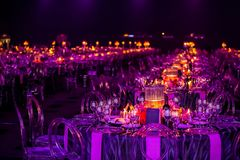 Decor for a large party or gala dinner. Purple and red decor with candles and lamps for corporate event or gala dinner royalty free stock photo
