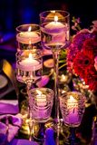 Decor for a large party or gala dinner. Purple and red decor with candles and lamps for corporate event or gala dinner Stock Images