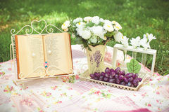 Decor on nature. Design a picnic on the grass Royalty Free Stock Photo