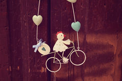 Decor object with girl riding a bike Royalty Free Stock Photography