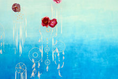 Decor with red flowers on blue gradient background on wall Royalty Free Stock Photo
