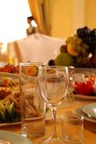 Decor in restaurant. Glasses, napkins. Evening Royalty Free Stock Images