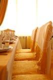 Decor in restaurant. Glasses, napkins. Evening Stock Image