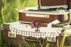 Decor with retro suitcases and player  records. Decor for event or photosession with old brown suitcases and player  records Stock Photo