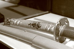 Decor of samurai sword. Sepia stock images