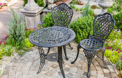 Decor table and chairs in garden Royalty Free Stock Photo