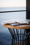 Decor. Table on the terrace of the restaurant by the sea Stock Photos