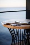 Decor. Table on the terrace of the restaurant by the sea Stock Photos