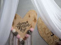 Decor for Valentine`s Day, two hearts on wooden background. Closed canopy Royalty Free Stock Photography