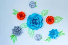 Decor on the wall - beautiful bright paper flowers. stock photography