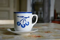 Porcelain mug with blue cherries. This decor was used around 1950. At present, it appears again royalty free stock photography