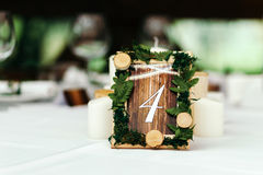 The decor at the wedding. Beautifully decorated table. The decor at the wedding. Beautifully decorated table, with the decor. The sign in rustic style, plates Royalty Free Stock Image