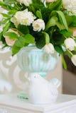 Decor of wedding ceremony. Decorative Stone vase with flowers and birds figure Stock Image