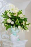 Decor of wedding ceremony. Decorative Stone vase with flowers and birds figure Stock Photo