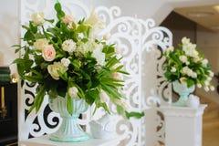 Decor of wedding ceremony. The decor of flowers of the wedding ceremony in the restaurant Royalty Free Stock Photo