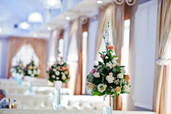 Decor on wedding reception, bouquets of flowers on vase with blu Royalty Free Stock Photos